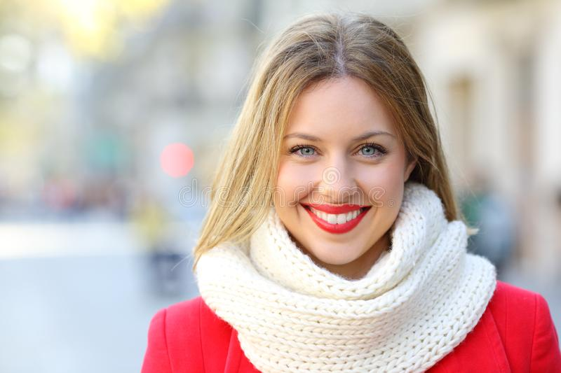 Portrait of a happy woman looking at camera in the city. Front view portrait of a happy woman looking at camera in the city street in winter stock photo
