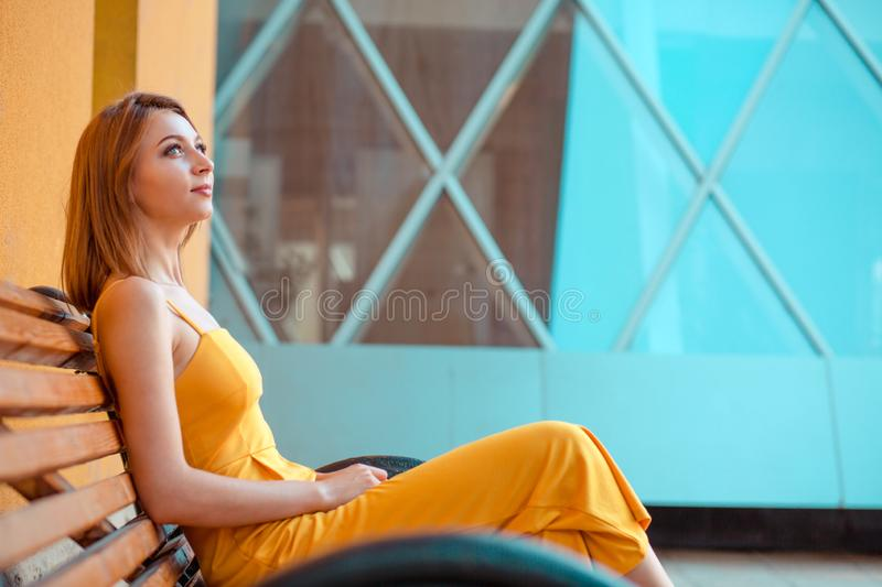 Portrait of a happy woman relaxing sitting on a bench outdoors stock image