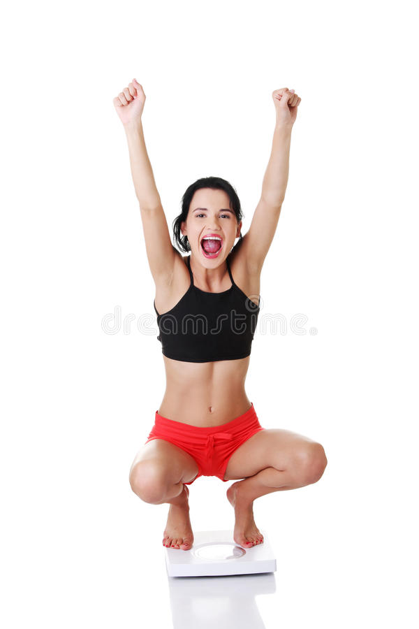 Download Portrait Of A Happy Woman On Scales. Stock Photo - Image: 27729556