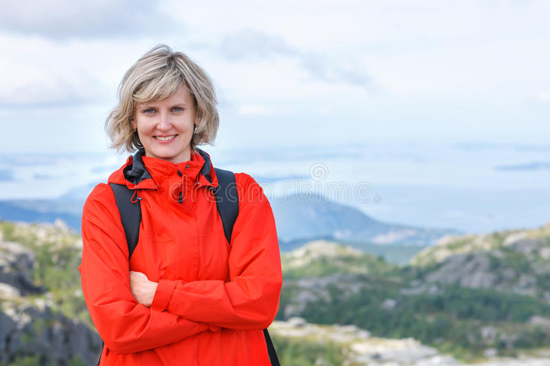 Portrait of happy woman tourist standing smiling outdoors royalty free stock photos