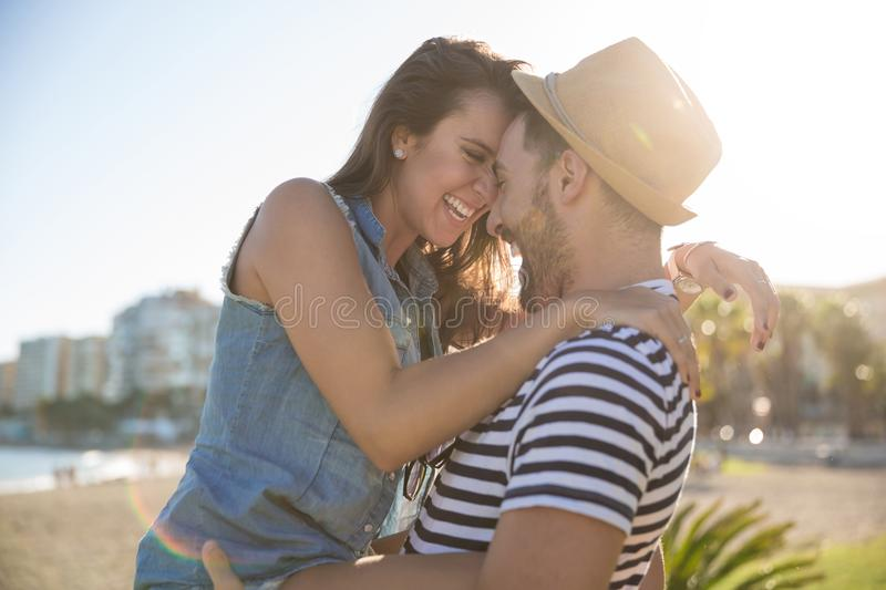 Happy woman leaning her forehead against her boyfriend stock photography
