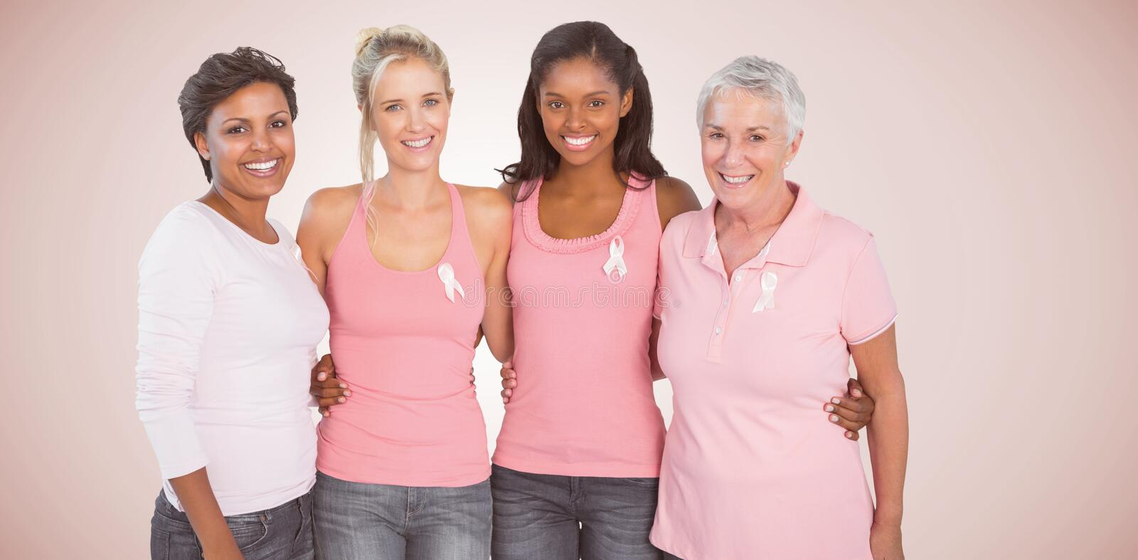 Composite image of portrait of happy women supporting breast cancer social issue. Portrait of happy women supporting breast cancer social issue against neutral stock photos