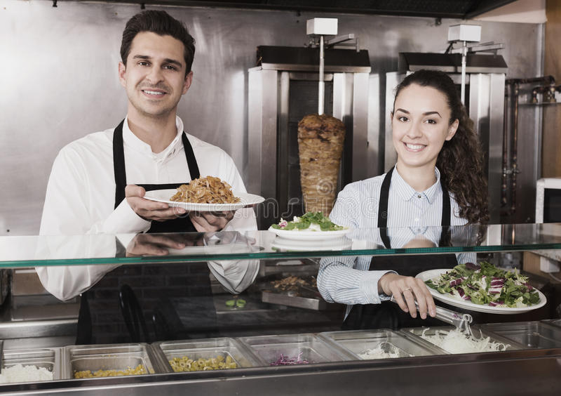 Portrait of happy workers with kebab stock images