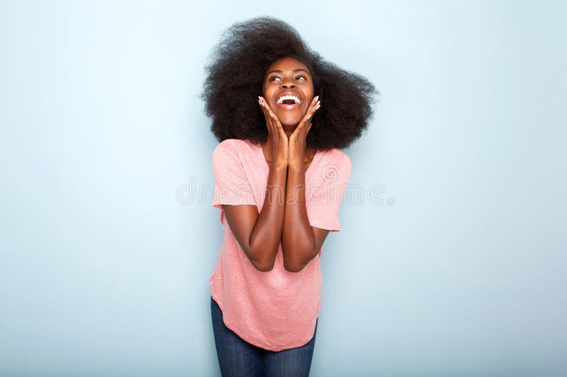 Happy young african american woman with hand to face stock photos