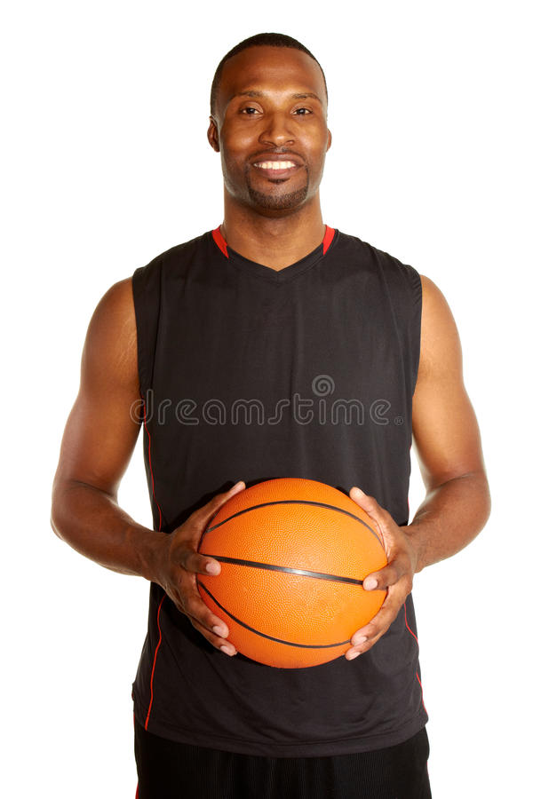 Portrait of a happy young basketball player stock photography