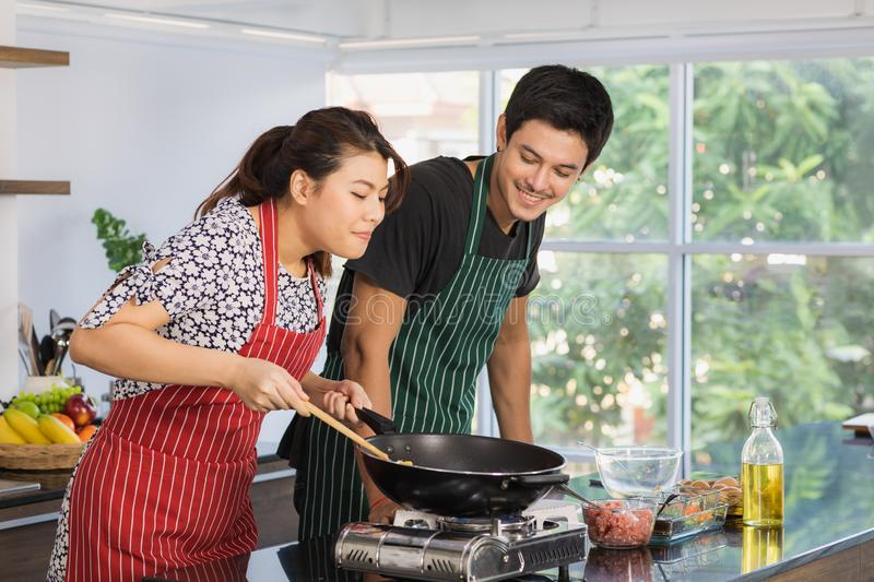 Asian couple at kitchen room royalty free stock image