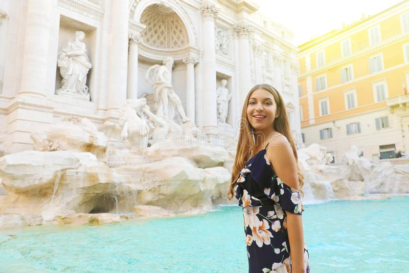Portrait of happy young beautiful woman in Rome with Trevi Fountain in the background stock photography