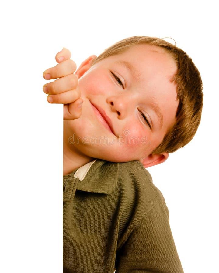 Portrait of happy young boy child peeking stock photo