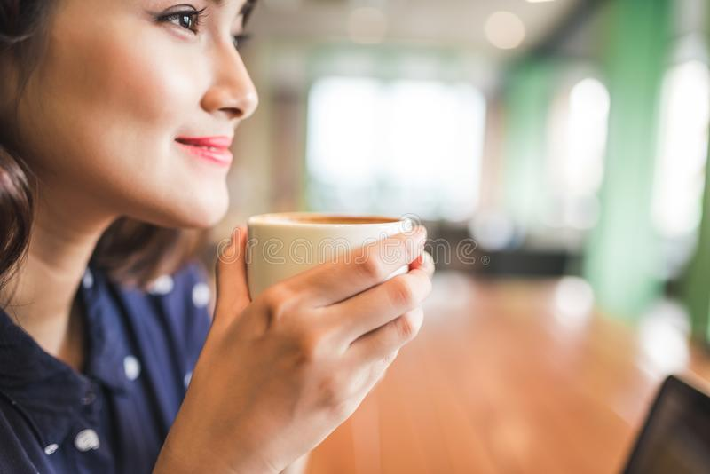 Portrait of happy young business woman with mug in hands, select. Ive focus royalty free stock images
