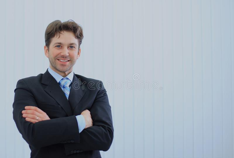 Portrait of happy young businessman at office. royalty free stock photography