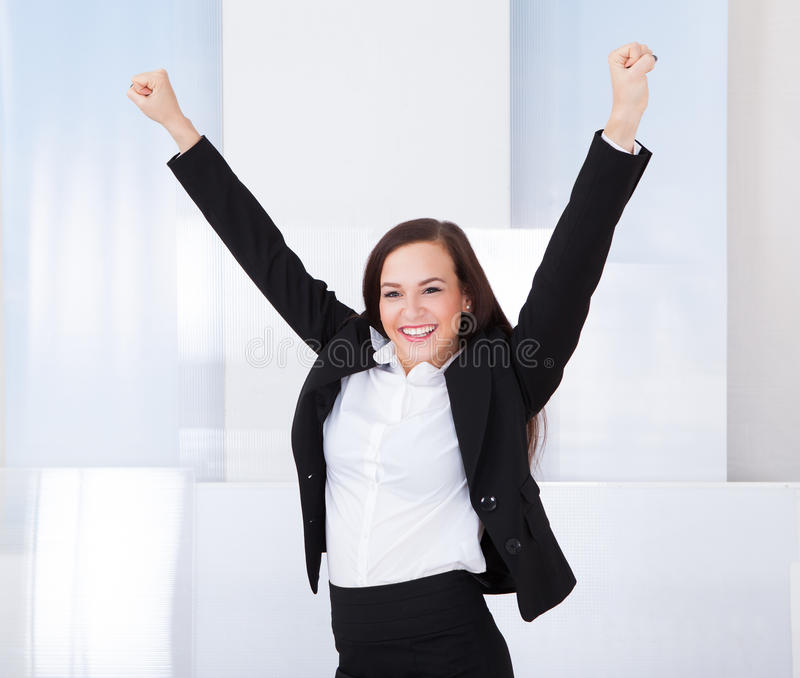 Portrait of happy young businesswoman. Standing in office royalty free stock photography
