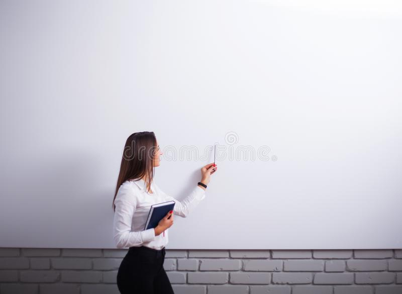 Portrait Of Happy Young Businesswoman woman near on white wall stock photos
