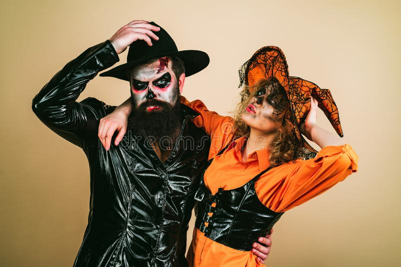 Portrait of happy young couple in Halloween with pumpkin. Happy Halloween. royalty free stock images
