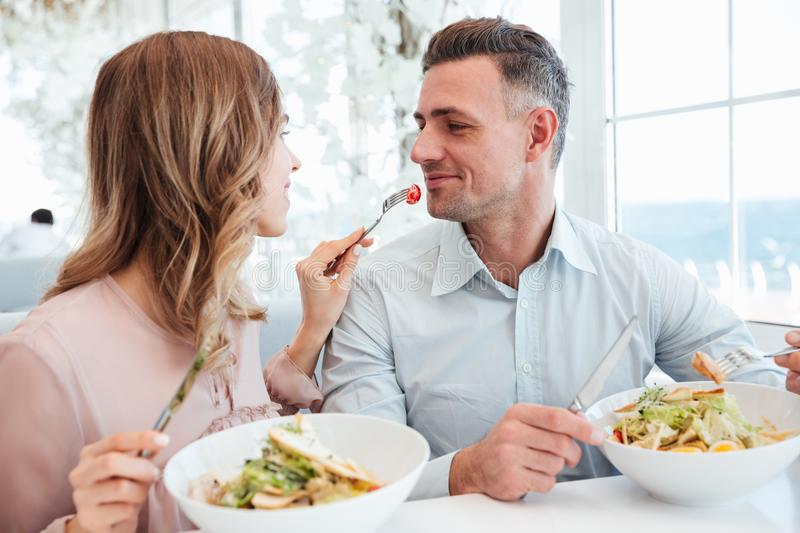 Portrait of a happy young couple having lunch royalty free stock photography