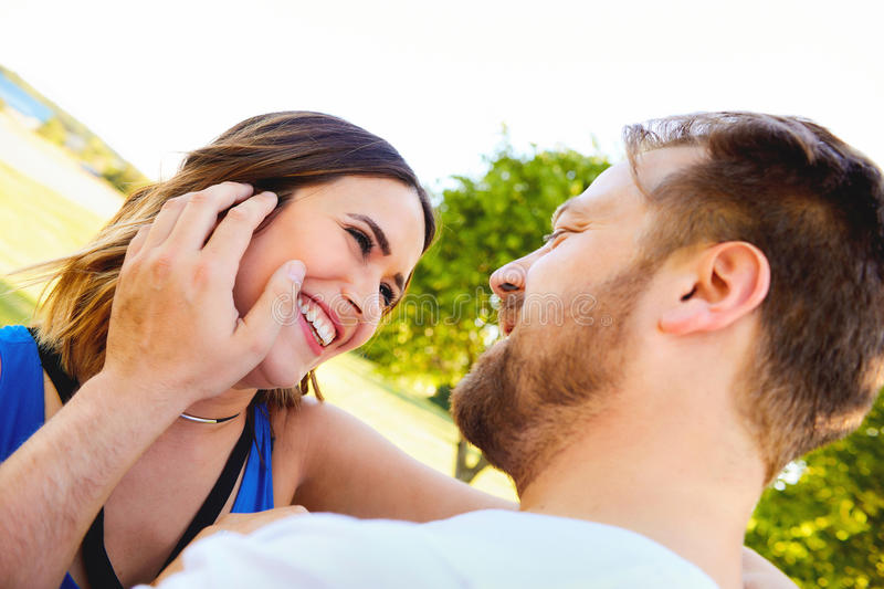 Portrait of happy young couple laughing outdoor royalty free stock photography