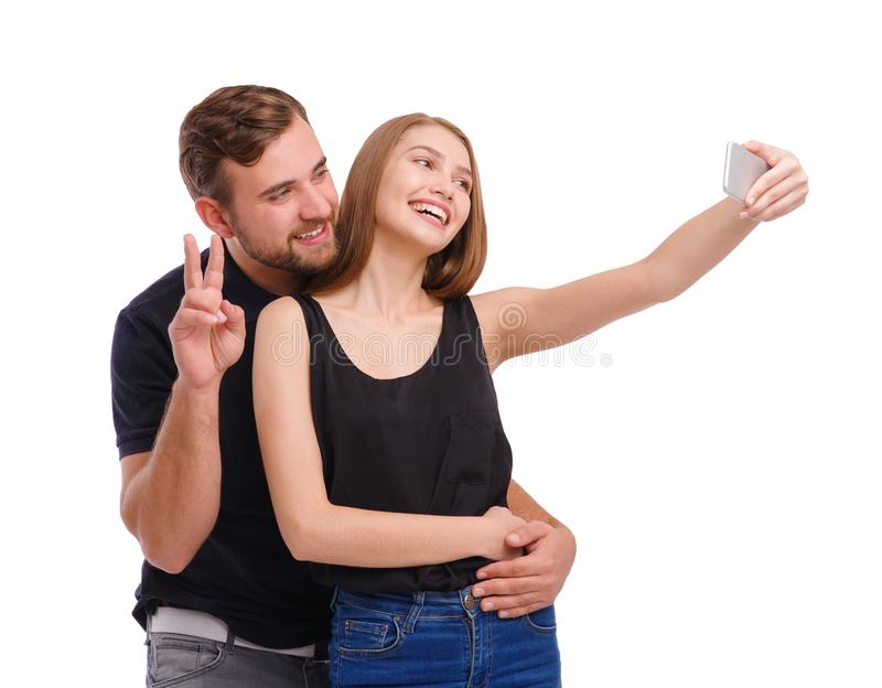 Portrait of happy couple making selfie, isolated on white background. stock images