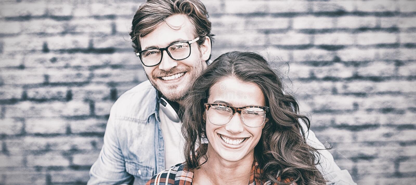 Portrait of happy young couple in spectacles royalty free stock photos