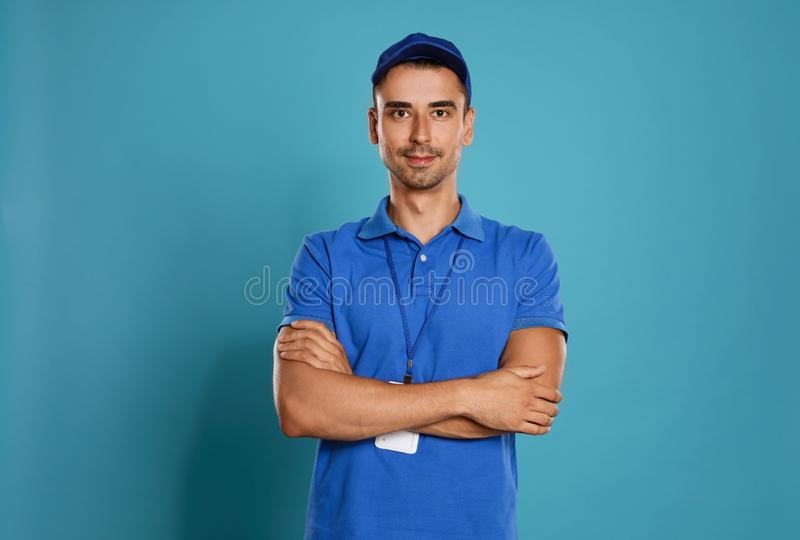 Portrait of happy young courier on background stock photos