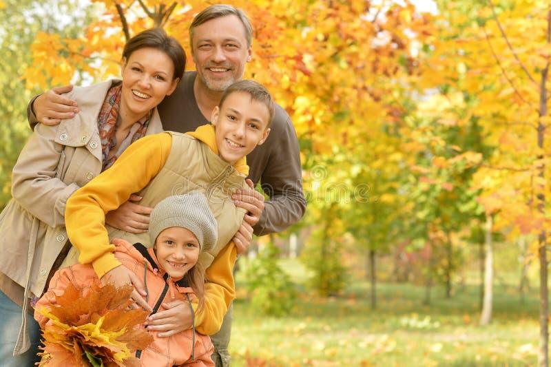 Portrait of happy family in autumn park stock photos