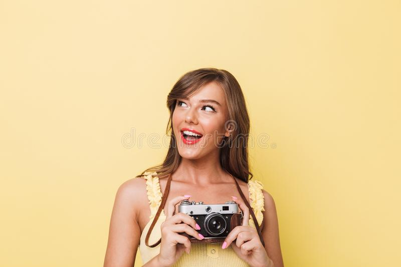 Portrait of a happy young girl holding photo camera stock photography