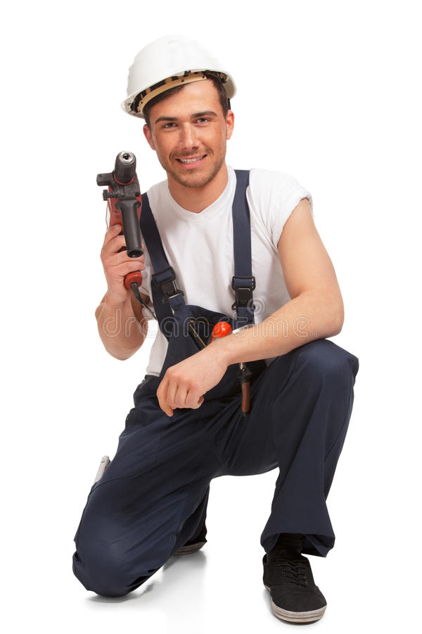 Download Portrait Of Happy Young Handyman With Tool Stock Photo - Image: 25846056