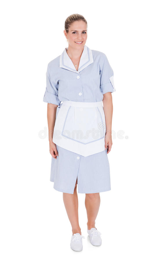 Portrait of happy young maid royalty free stock photography