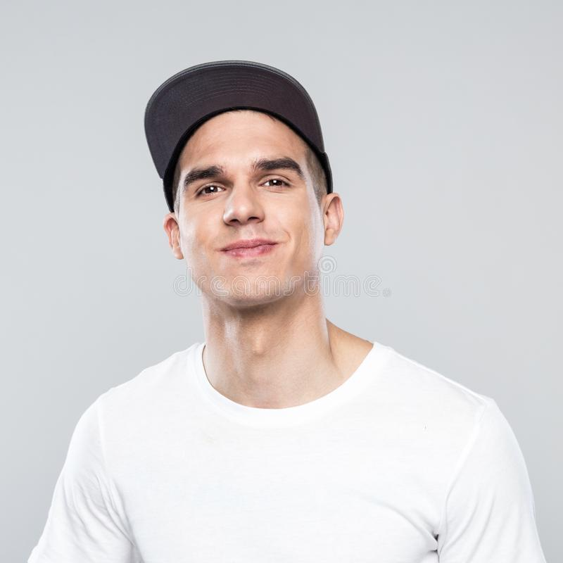 Portrait of happy young man in baseball cap royalty free stock images