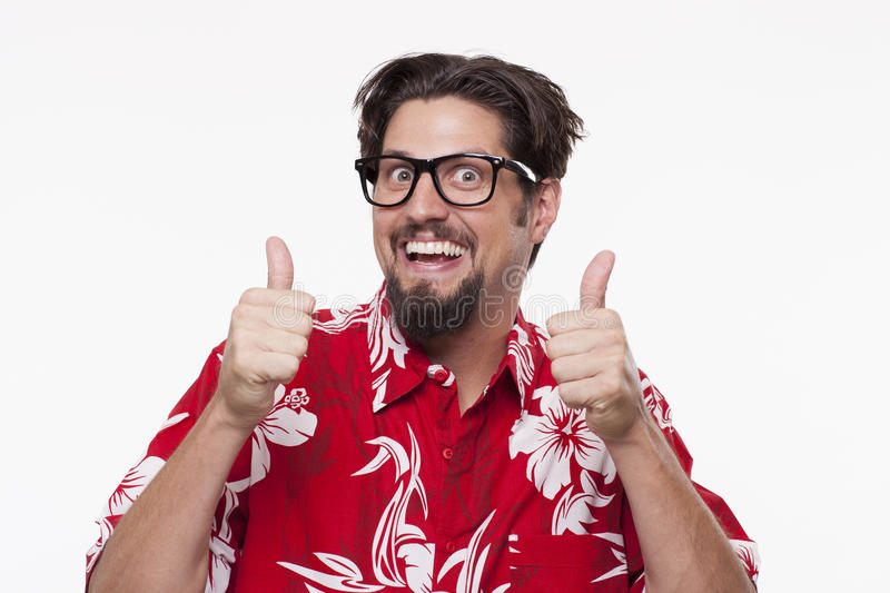 Portrait of a happy young man gesturing thumbs up against white royalty free stock photography
