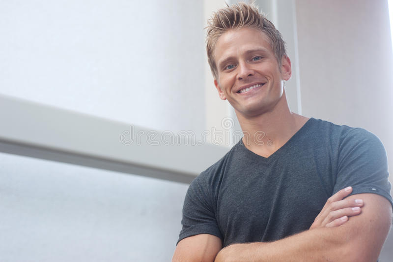 Portrait of a happy young man looking at camera royalty free stock photos