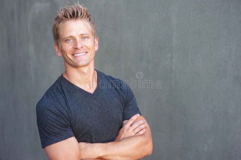 Portrait of a happy young man looking at camera royalty free stock images