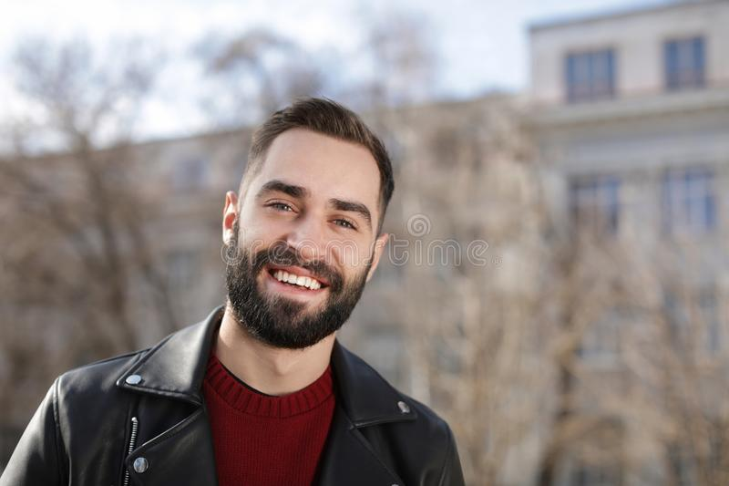 Portrait of happy young man outdoors stock photography