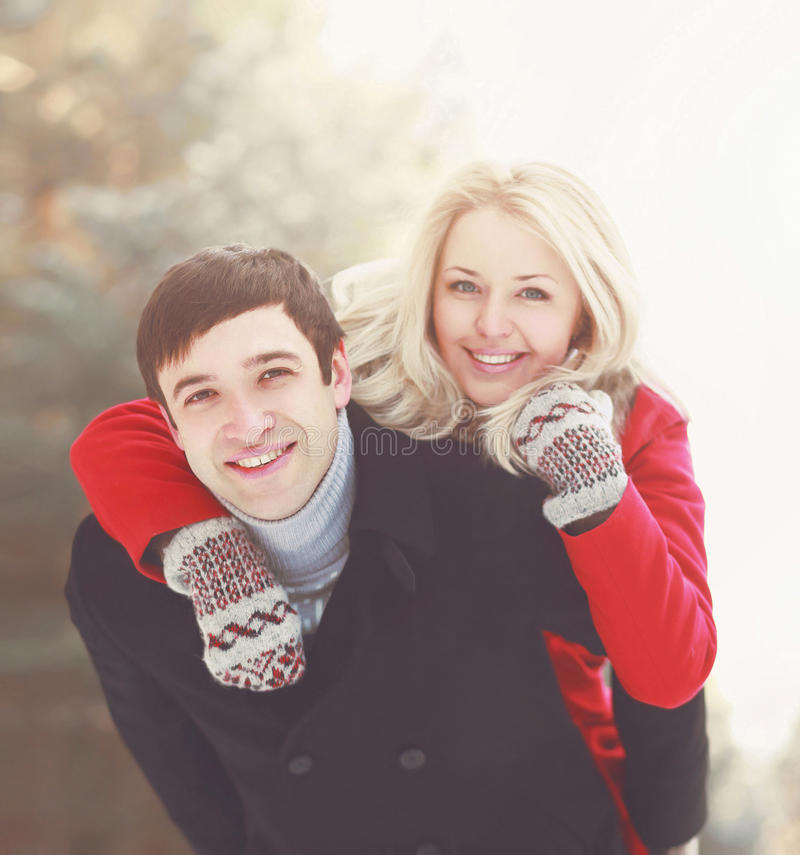 Portrait happy young smiling couple in love having fun at winter day royalty free stock images