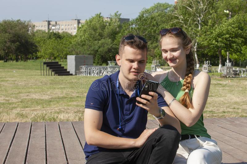Portrait happy young smiling couple in love over flowering spring garden stock images