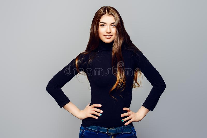 Hair care cosmetics. Portrait of a happy young woman with beautiful smile. Long hair concept. Hairstyle, healthy hair. Cosmetics and make-up royalty free stock photography