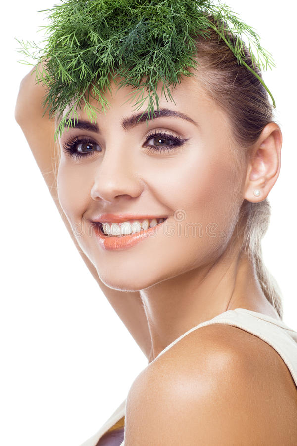 portrait of happy young woman with bundle herbs (dill) stock images