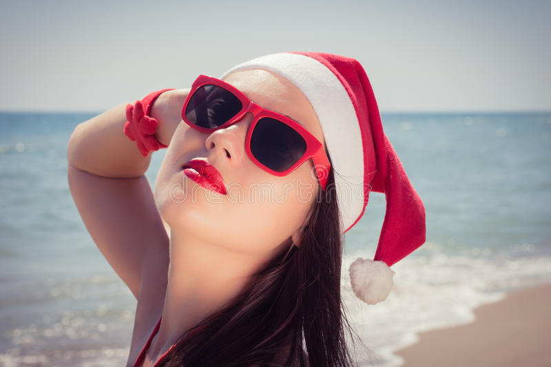 Portrait of a happy young woman enjoing her Christmas vacation royalty free stock photo