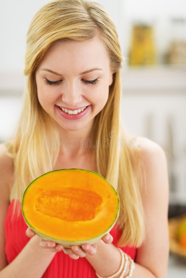 Portrait of happy young woman holding melon royalty free stock photography