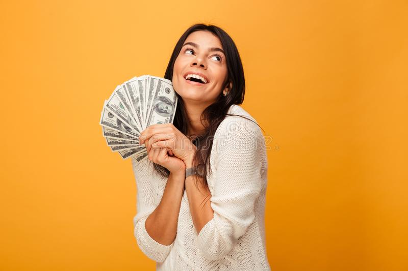 Portrait of a happy young woman holding money banknotes royalty free stock photography