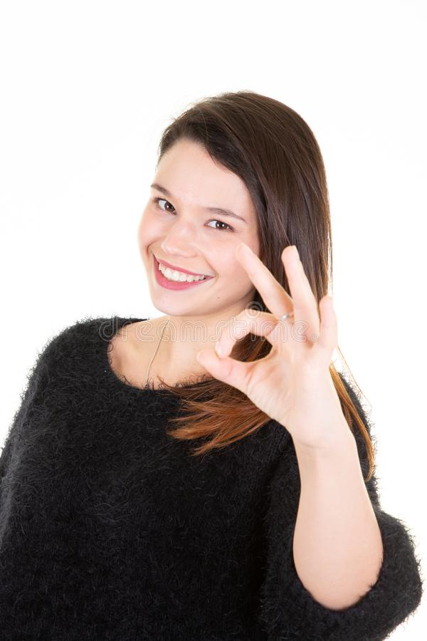 Portrait of happy young woman showing ok sign finger gesture stock image
