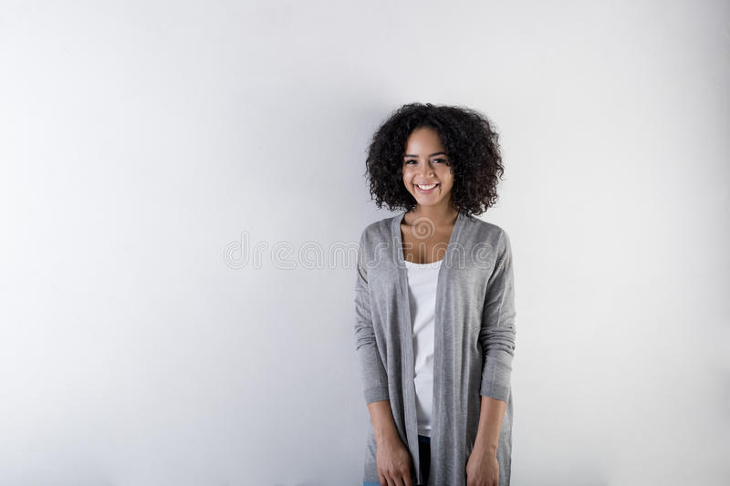 Portrait of happy young woman standing in studio royalty free stock photos