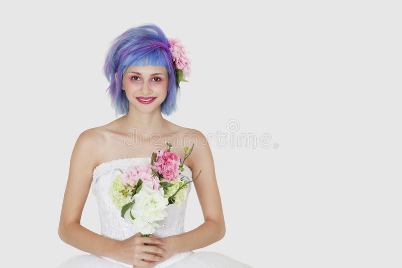 Download Portrait Of Happy Young Woman In Wedding Dress With Dyed Hair Against Gray Background Stock Photo - Image: 30851884