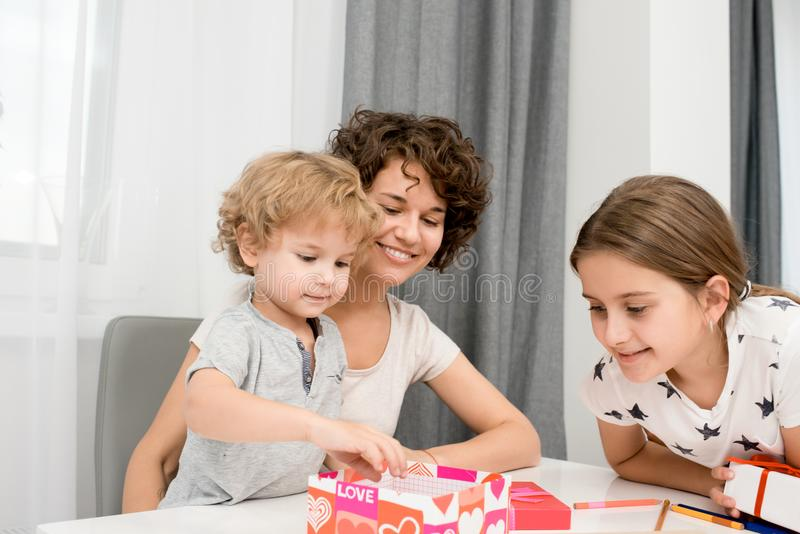 Young Woman with Two Kids stock images