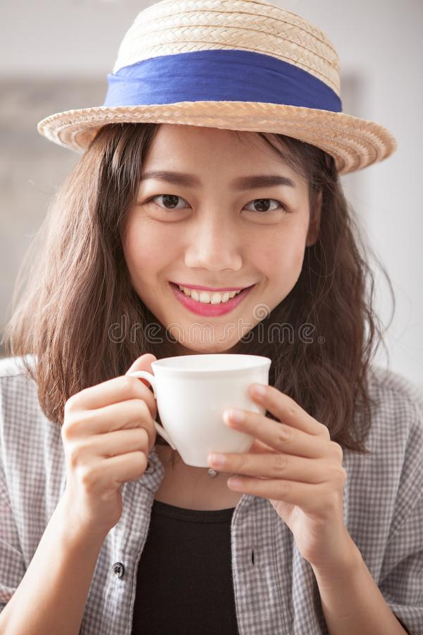 Portrait head shot of beautiful younger asian woman and hot coffee cup in hand happiness emotion royalty free stock photos