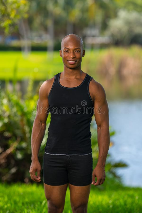 Portrait of a healthy young fitness model in a tank top royalty free stock photography