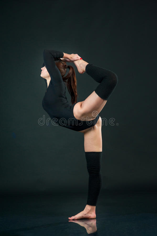 Portrait of healthy young woman doing yoga exercise ove stock images