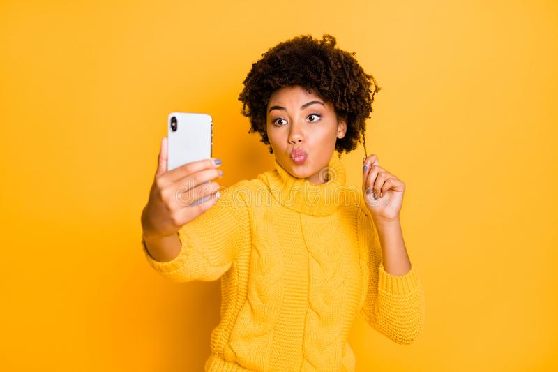 Portrait of her she nice attractive charming lovely flirty feminine wavy-haired girl taking selfie sending kiss pout. Portrait of her she nice attractive royalty free stock photos