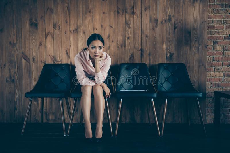 Portrait of her she nice attractive elegant trendy lady qualified specialist partner sitting on chair waiting for. Meeting ceo boss chief at modern industrial stock photography