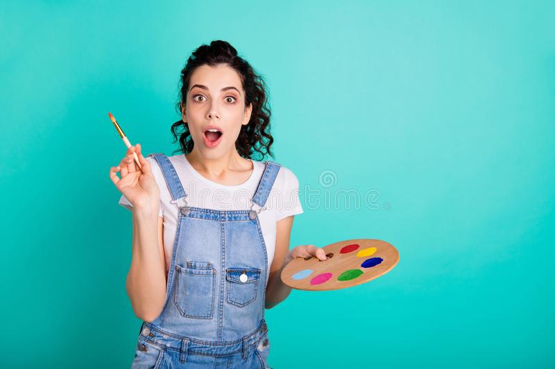 Portrait of her she nice attractive lovely charming amazed creative wavy-haired girl wearing casual holding in hands. Portrait of her she nice attractive lovely stock photography
