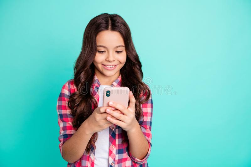 Portrait of her she nice attractive lovely charming cute cheerful wavy-haired pre-teen girl wearing checked shirt stock photo
