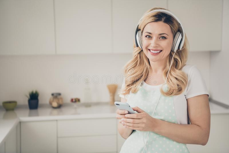 Portrait of her she nice attractive lovely cute cheerful cheery wavy-haired lady maid having fun free spare time track royalty free stock image